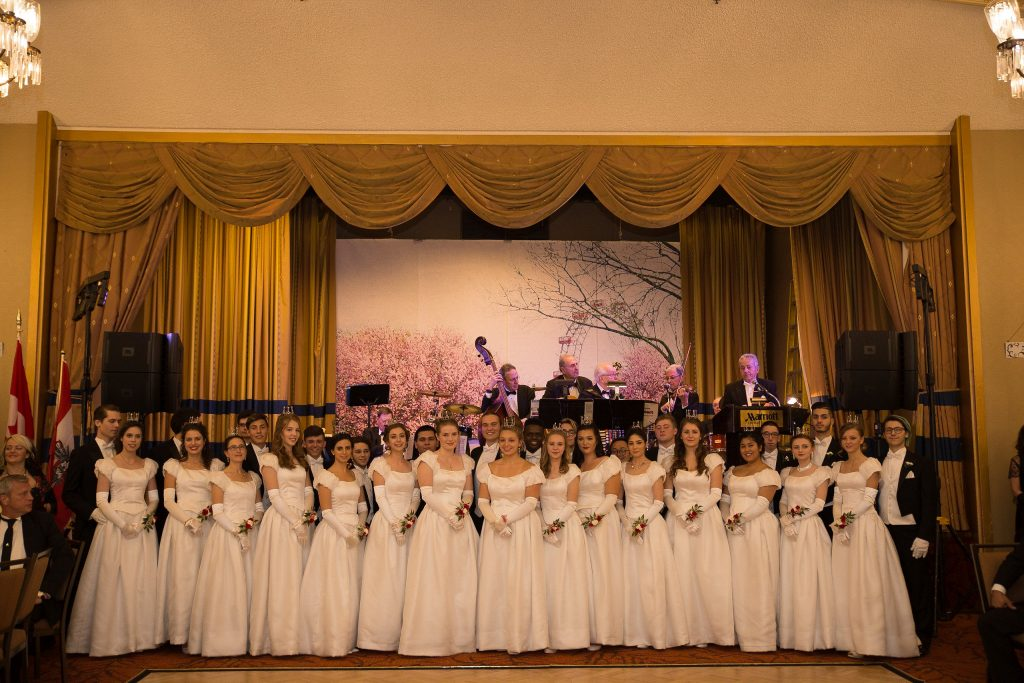 Debutantes and Escorts in the Ballroom in front of the stage, listening to the opera singers